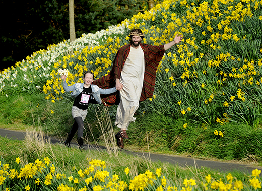 The Easter Play actor Duncan Rennie in Princes Street Gardens, Edinburgh, on a scooter