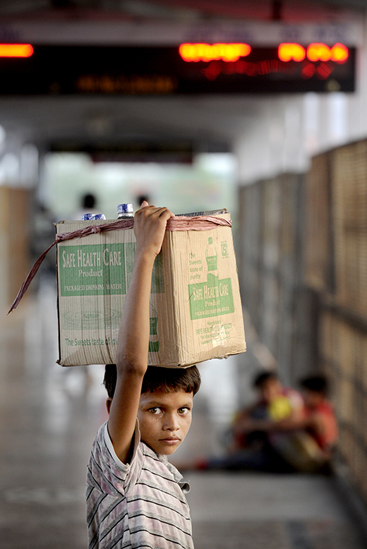 A child water seller at Gorakhpur Junction station, Uttar Pradesh, India - one of several main hubs used by traffickers to abduct lone children