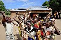 Women celebrating arrival of a 'solar kiosk' centre in their isolated village in Machinga district, Malawi - part of the Scottish Government's Climate Challenge Programme Malawi [CCPM] project