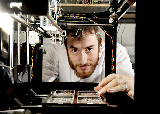 Alan Faulkner-Jones with a 'printer' which manufactures human liver tissue